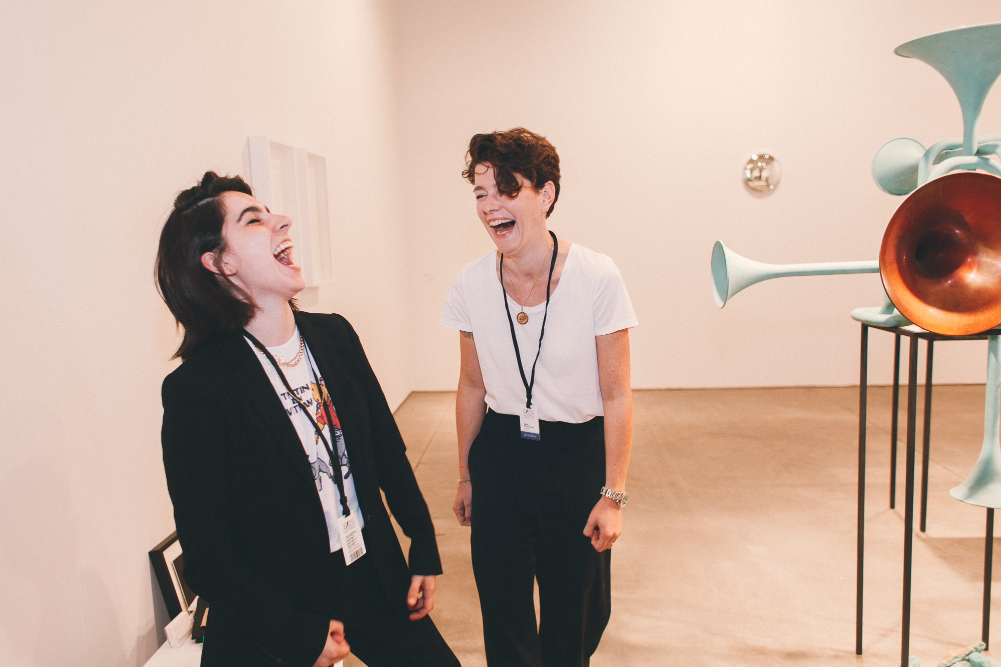Laura Attanasio (left) and Sarah Miltenberger of König Galerie look effortlessly chic in black and white.