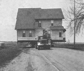 Houses that were once scattered across thousands of acres were hauled by truck to a centralized location, called Fermilab village, that now provides lodging for students and scientists.