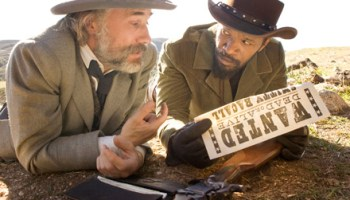 Christoph Waltz and Jamie Foxx hunt racist whites in Quentin Tarantino's <i>Django Unchained</i>.