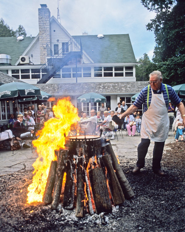 The crowning moment of a fish boil: when the boilmaster pours kerosene on the flames.