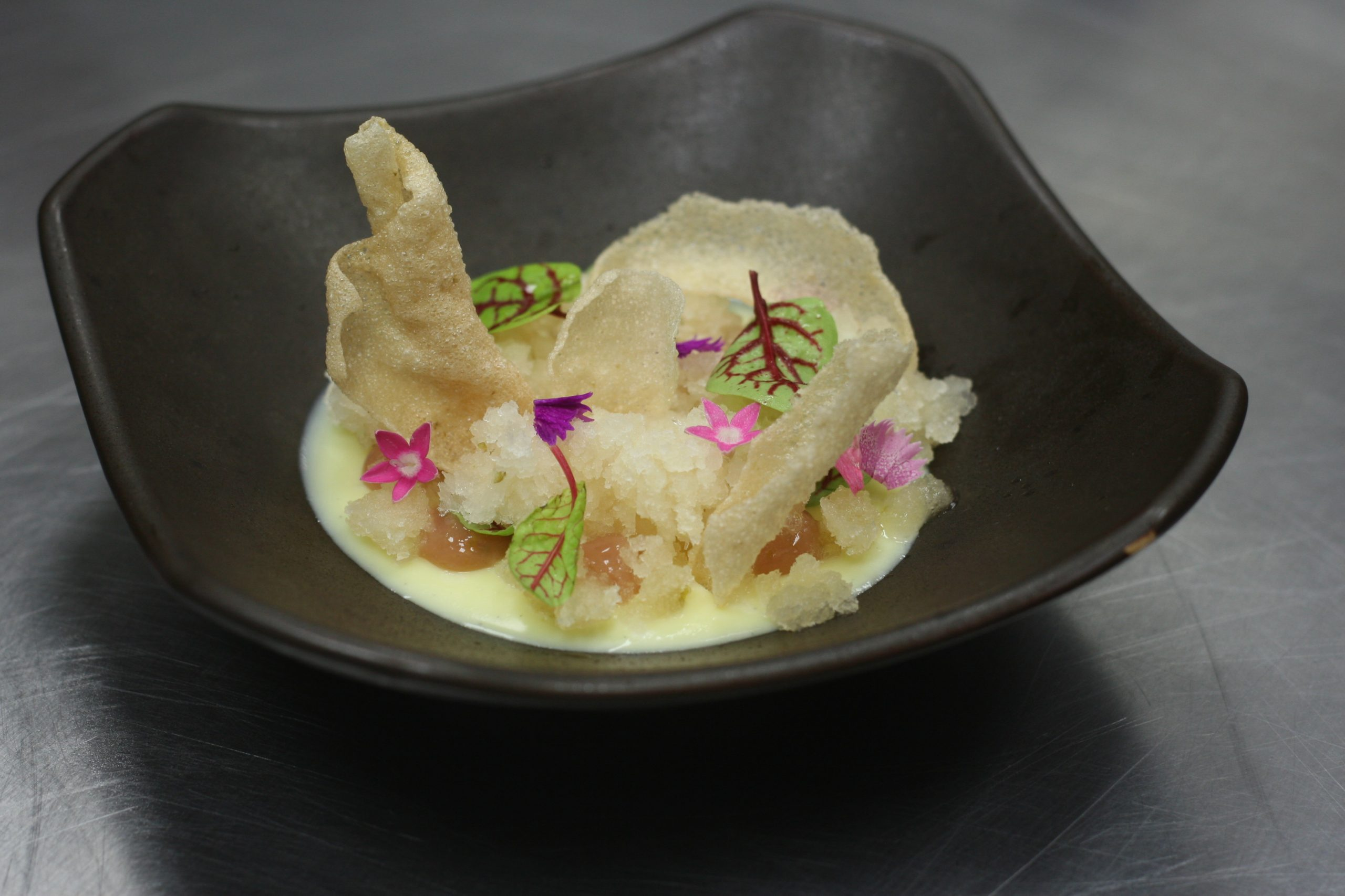 """In preparing a """"pre-dessert,"""" Hanbun chef David Park started with a white chocolate cremeux (a French custard) and then added yuzu kosho to every other element."""