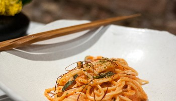 A spool of spaghetti enriched with the egg of the free-range Jidori chicken, tossed with tiny, spicy pollock roe