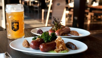 Smoked knockwurst (foreground) and seared boarwurst with house hefeweizen