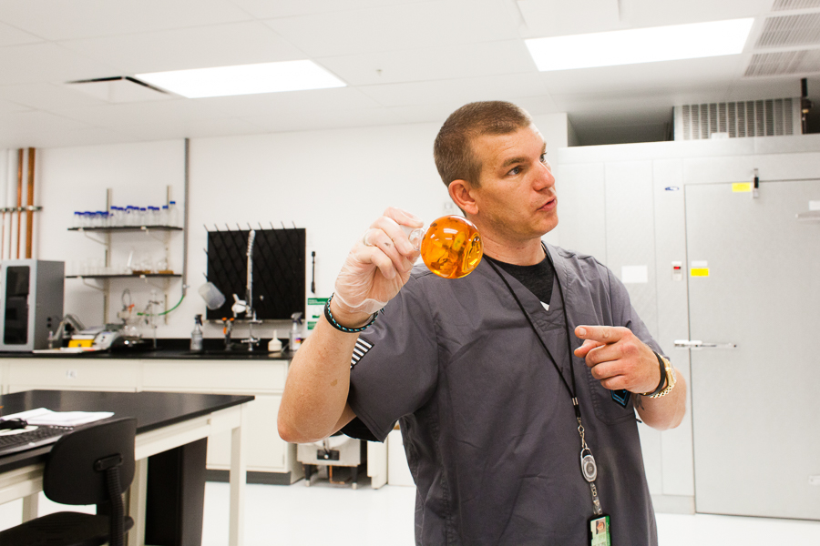 Revolution founder and president Tim McGraw holds a beaker of 98 percent pure THC.