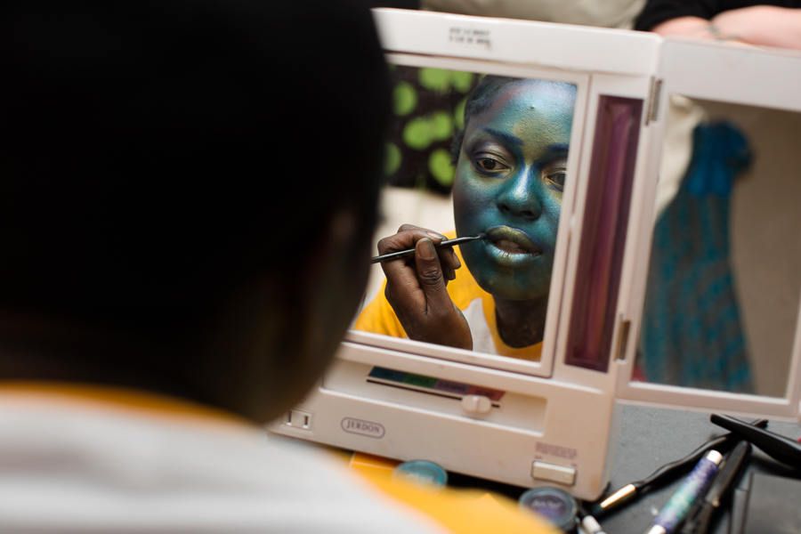 """Ebijimi applies a mask of iridescent makeup, including a line of dark blue around her lips to make them pop during her lip-sync routine. """"It's easier for me to do colorful faces,"""" she says."""