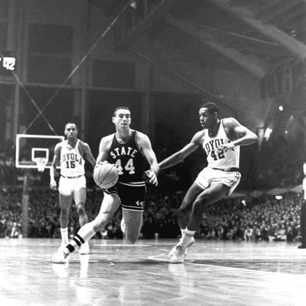 The 1963 NCAA regional semifinals pitted all-white Mississippi State against integrated Loyola—and helped change the color of college basketball.