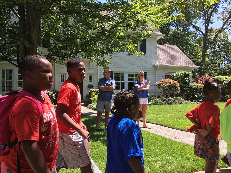 Parents, students, and activists marched through Illinois governor Bruce Rauner's Winnetka neighborhood on July 25 to protest cuts to the Child Care Assistance Program.