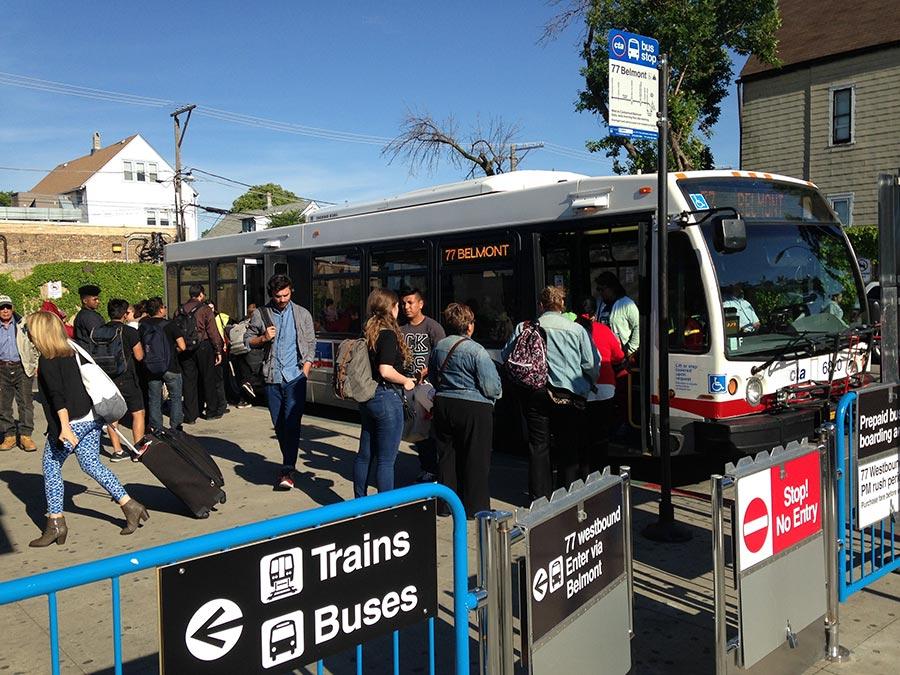 Passengers board a westbound CTA #77 Belmont bus through both doors.