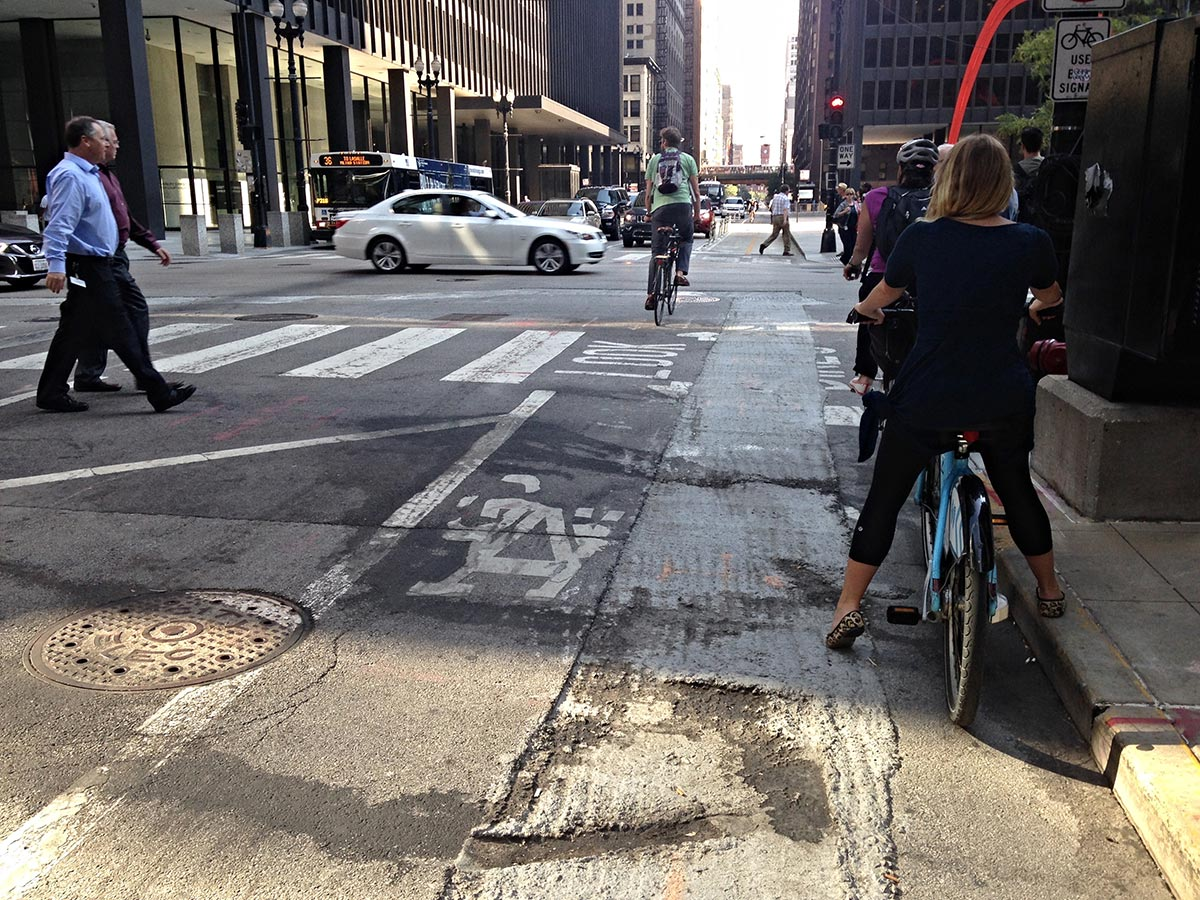 Lousy pavement in the Dearborn two-way protected bike lane.