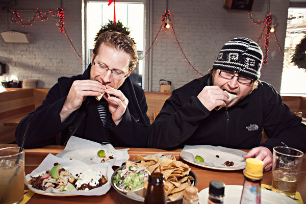 Philip Foss and Matt Maroni eating tacos at Big Star