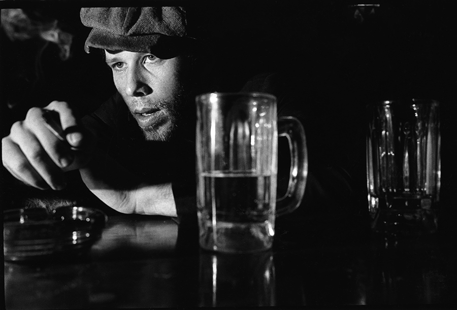 """<b><i>Tom Waits</i><br/> By Eric Futran</b><br/><br/>Futran says: <i>""""I heard Tom Waits on a radio concert some time in the late 70s, and my mind was blown. When I found out he was performing in Chicago I asked for an assignment to shoot his picture. When I arrived at the Quiet Night an hour before the show, I found some guy in a Tom Joad hat with his head down on the bar, cigarette in hand, nursing a beer. It was Waits.""""</i>"""