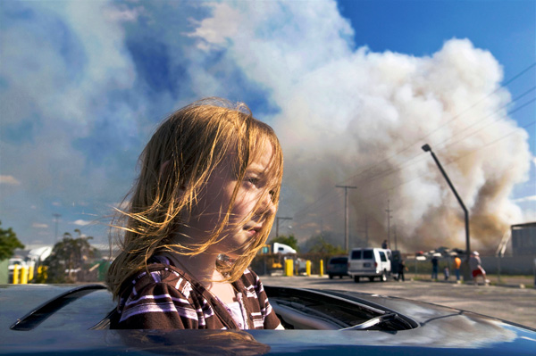 Girl at a junk yard fire in East Chicago