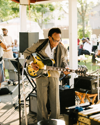 Jazz guitarist George Freeman, younger brother of late saxophonist Von, sits in at the Wright Gathering.