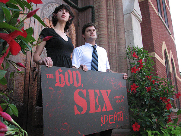 Host Danny Black (right) with coproducer Angela Vela. Their show, <i>God, Sex, and Death Variety Hour</i>, plays the first Wednesday of every month.