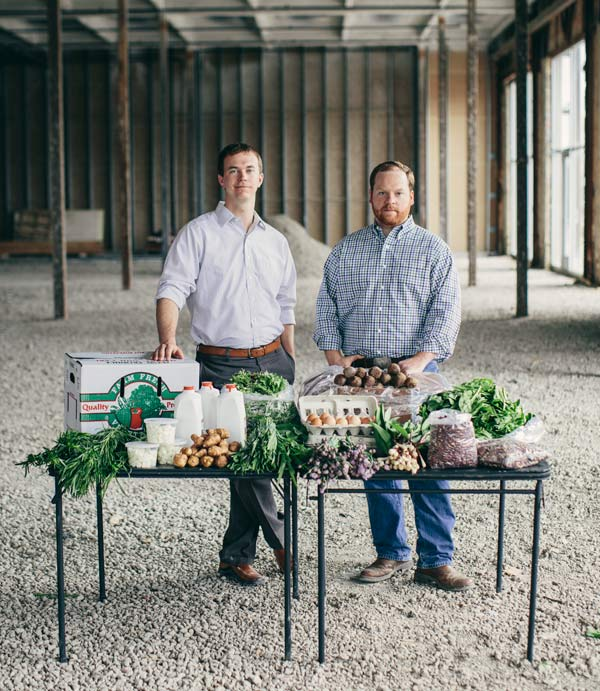 Local Foods Grocer cofounders Andrew Lutsey and Dave Rand, in the warehouse they hope to open to the public, are working to clear the hurdles that keep locally grown produce from being more widely available.