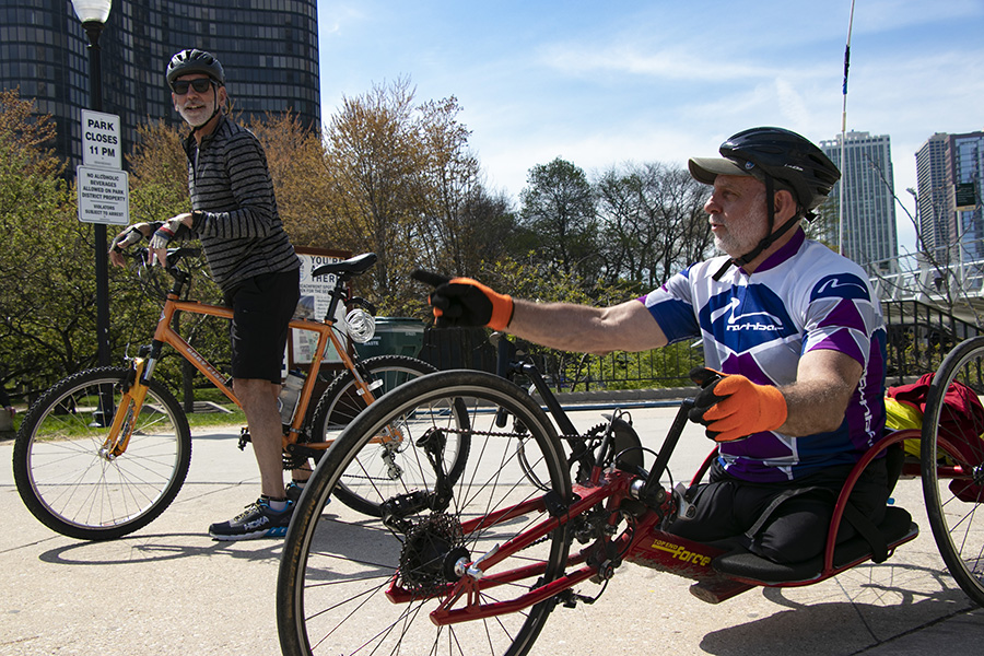 Lenzo and his brother, Steve, hand-cycle from Oak Park to Navy Pier. Lenzo usually handcycles about 20 miles twice a month with Steve.