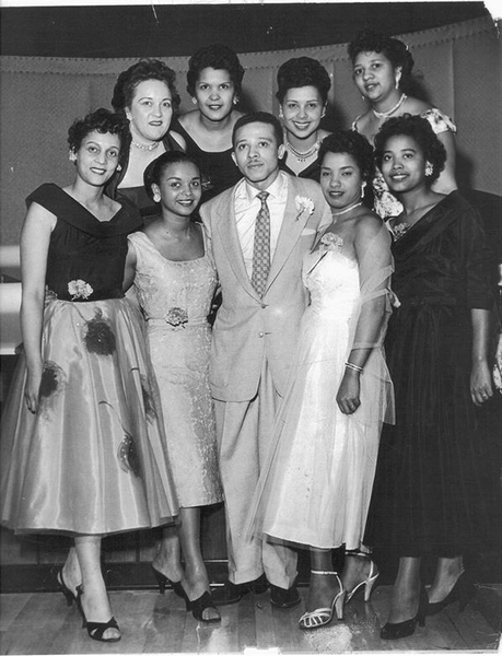 Herman Roberts at age 35, surrounded by women he employed at his nightclub