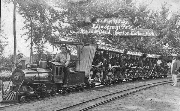 The bearded, long-haired members of the House of David's baseball team aboard one of the famous miniature trains.