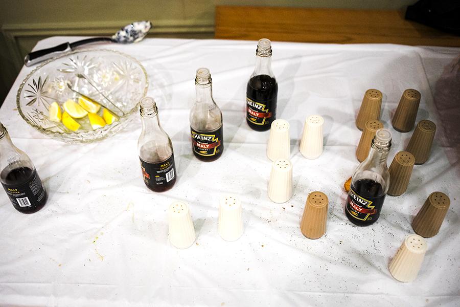 Bottles of malt vinegar, salt, pepper, and lemons litter the garnishments table at the Irish American Heritage Center's Annual Lenten fish fry.