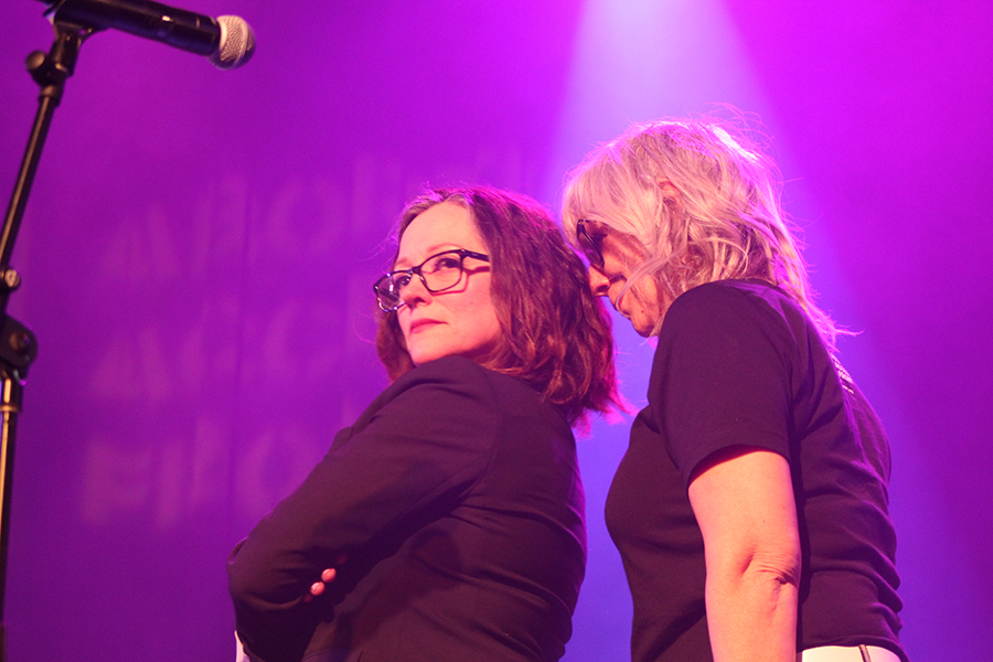 """Lizz Winstead stands too close to Nora O'Connor during her version of the Police's """"Don't Stand So Close to Me."""""""