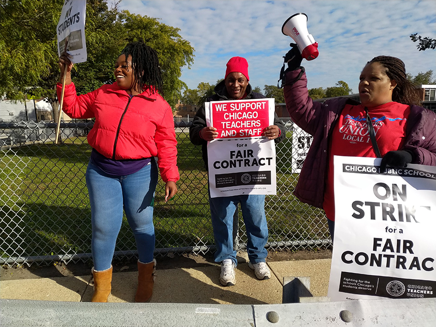 Picketing teachers solicited horn honks from passing cars on 71st Street in Englewood.