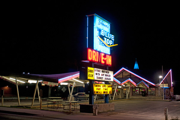 At Johnsen's Blue Top Drive-In, you can (and should) order a Big Ben double cheeseburger and a house-made root beer black cow from a living, breathing teenage carhop.