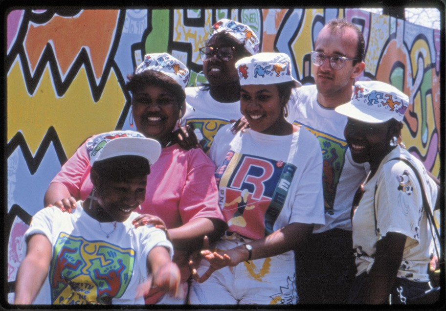 Haring with some of the 500 CPS students who were his collaborators on the mural
