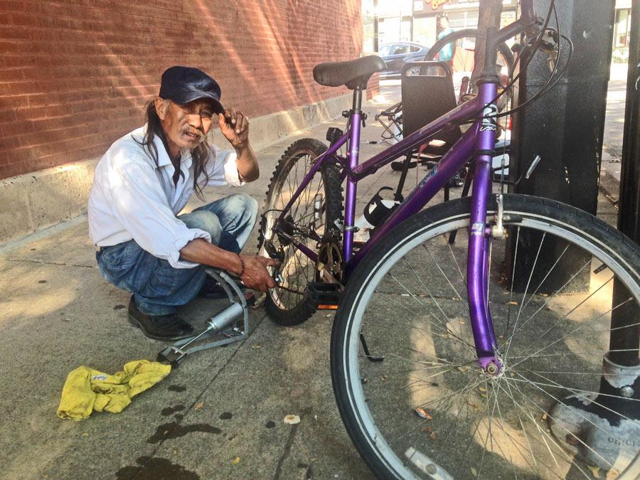 Kent Moy and his makeshift bike repair shop