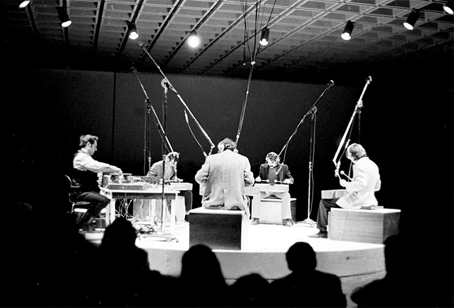 Steve Reich (left) guides Philip Glass, Jon Gibson, Richard Landry, and Arthur Murphy in a performance of his new work <i>Four Log Drums</i> at the Whitney Museum of American Art in 1969.