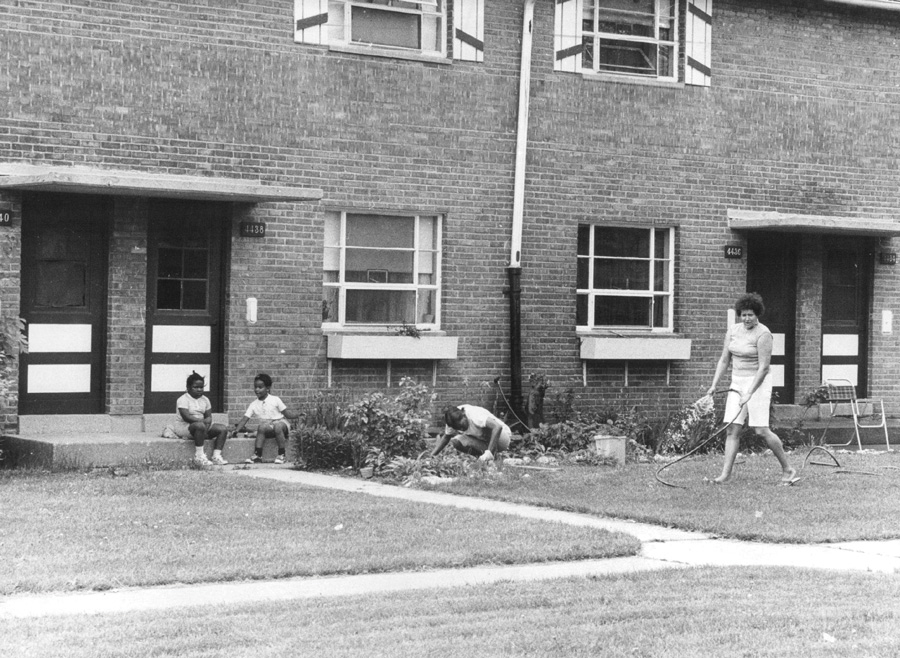 Tenants work on the flower garden outside a LeClaire Courts apartment in 1975.
