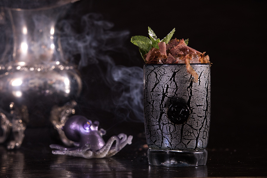 The Leviathan's combination of rum, ginger, angostura, and mint steer it into tiki territory, but the gin and aquavit add a backbone of herbal anise notes, while the bonito flakes that garnish it add a faintly fishy smokiness.