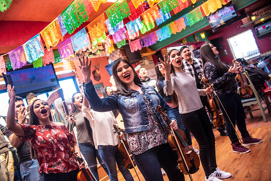Mariachi Herencia de Mexico perform out of uniform at the Mi Tierra restaurant in Little Village this spring.