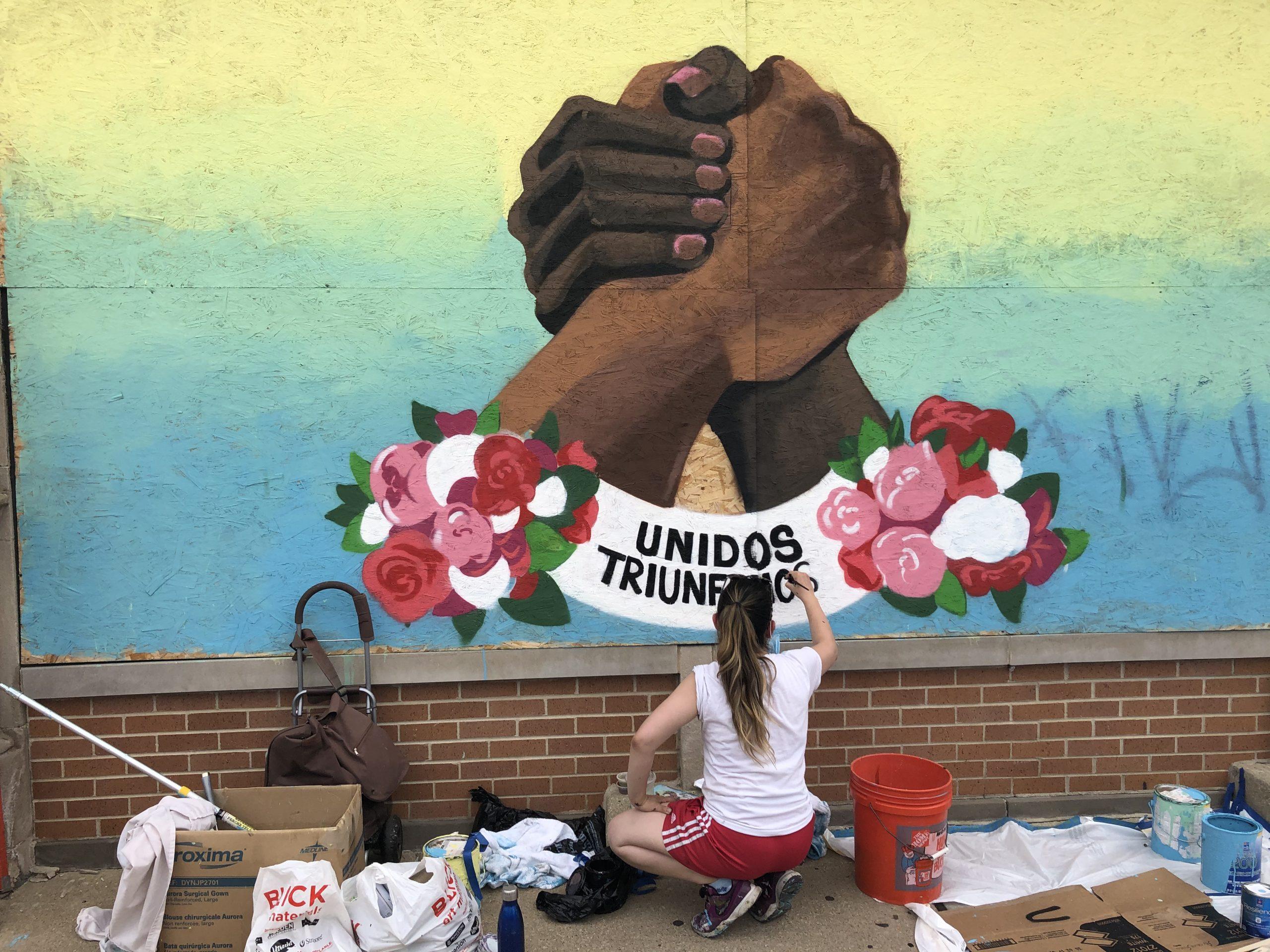 Veronica Martinez working on her third mural for Alivio Medical Center in Little Village.
