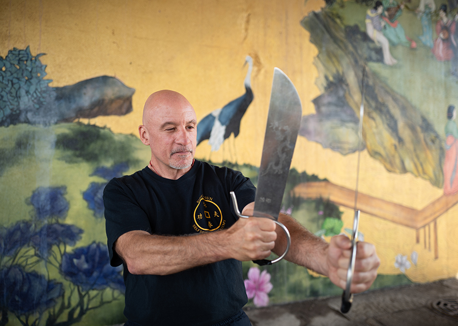 Sifu Matthew Johnson, of the Ving Tsun Self Defense Academy, practices with butterfly knives in Chinatown's Ping Tom Park.