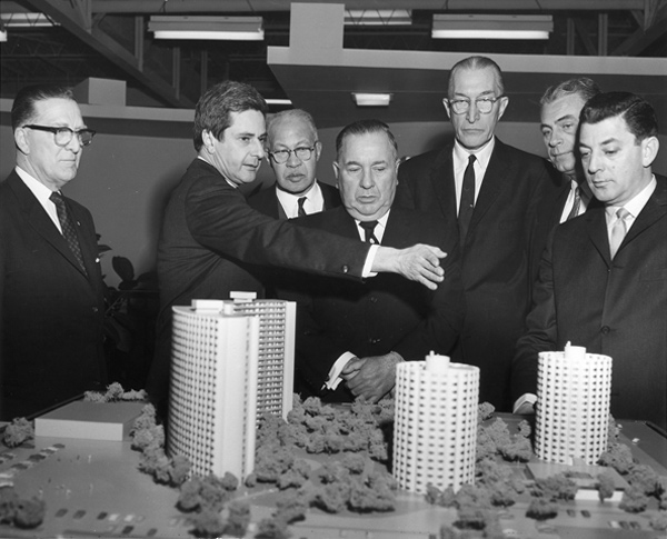 Mayor Richard J. Daley with a model of the Raymond Hilliard Homes
