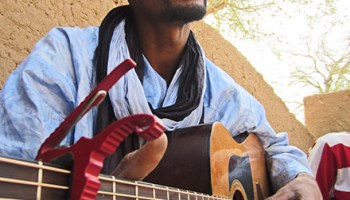 """Mdou Moctar of Abalak, Niger, does a persuasive impression of a robot muezzin on the <i>Music From Saharan Cellphones</i> track """"Tahoultine"""""""