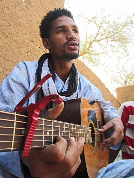 """Mdou Moctar of Abalak, Niger, does a persuasive impression of a robot muezzin on the Music From Saharan Cellphones track """"Tahoultine"""""""