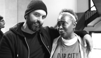 """Activist N'Dana Carter and fellow protester """"Mo"""" at the Woodlawn mental health clinic. Mo turned out to be an undercover police officer named Mehmet Uygun."""