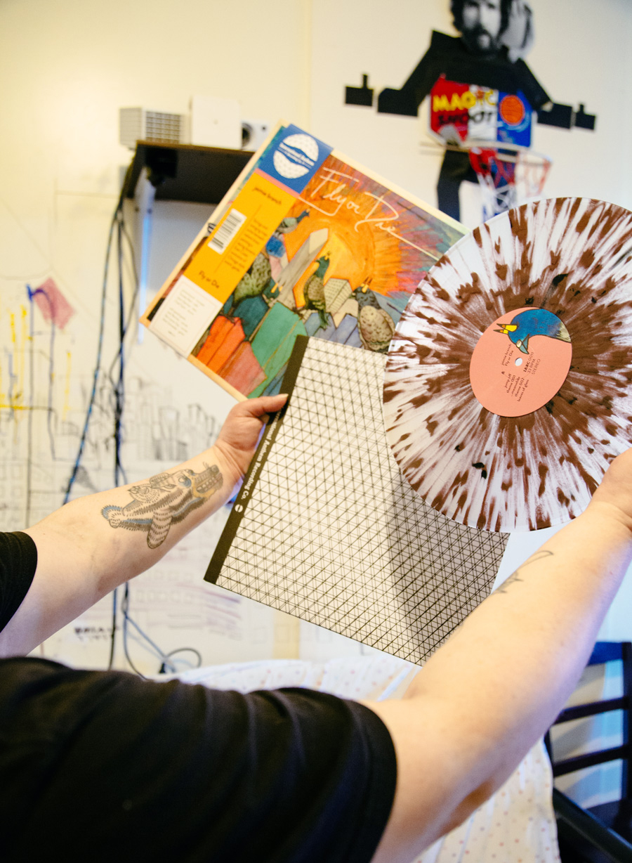 """Branch shows off the """"pigeon shit"""" vinyl of her new LP, <i>Fly or Die</i>."""