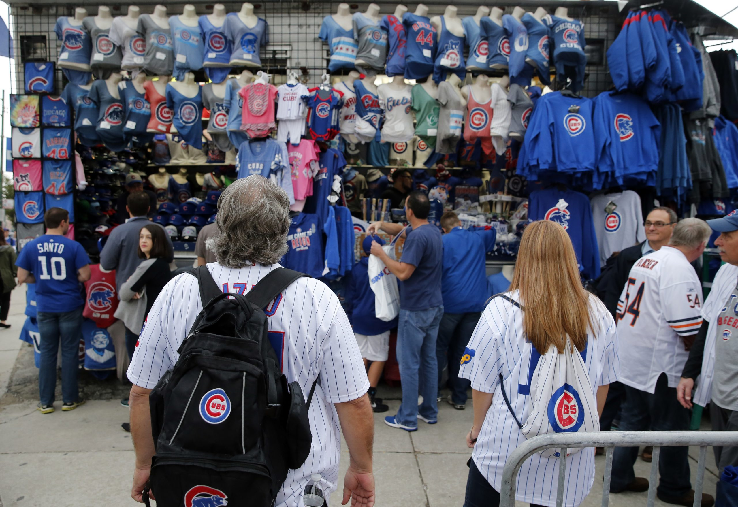 Fans look at Cubs merch outside Wrigley Field before game two of the NLCS.