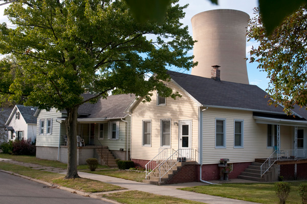 Coal-fired power plant, originally designed as a nuclear plant, A cooling tower looms over a home in Michigan City.