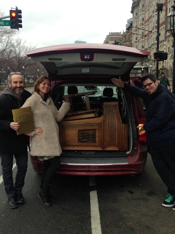 Nancy Faust's Hammond organ—which barely fit into the rental van—arrives in Boston. From left to right: Gerald Dowd, Freda Love Smith, and Chicago musician and sports journalist Matt Spiegel.