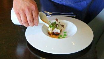 Pandan-steamed halibut with kaffir-pandan gel and coconut, lobster, and pandan leaf broth