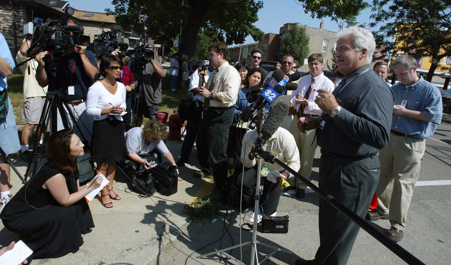 Camden, pictured in 2003 during his time as a CPD spokesman, has often been the only voice of authority talking to reporters immediately after a police shooting.