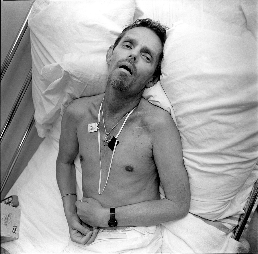 """<b><i>Eight Months in the Death of Robert Thomas</i>, 1991 from <i>Faces of Aids: Life and Death at Bonaventure House</i>, published March 27, 1992<br/>By Paul Meredith</b><br/><br/>  Meredith says: <i>""""When I first met Robert in August of 1990, he was still relatively healthy and strong. He was 41. He had eight months left.<br/><br/>  Robert, who had made a good living selling real estate, was a detail person. He settled his financial affairs, arranged a living will, and purchased a vault for himself at Rosehill Cemetery. He labeled the drawers of his dresser so that when he became too weak to care for himself, the volunteers would know not to put his socks in his underwear drawer. As his condition worsened he seemed to relish smaller and smaller things: a poem read to him by a friend; the smell of the air in spring, his last.<br/><br/>   For some residents, Bonaventure House is their only home, and its community their only family. Robert was one of these. His closest living relative, a sister somewhere in the south whom he loved very much, never came to visit him. She has two kids. She was afraid. He never complained. She sent a beautiful bouquet of flowers when he died.""""</i>"""
