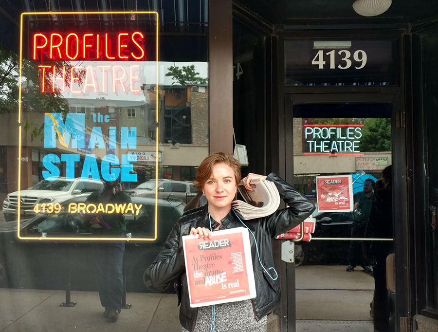 Couling in front of the theater's front door, where someone had already taped a copy of the paper.