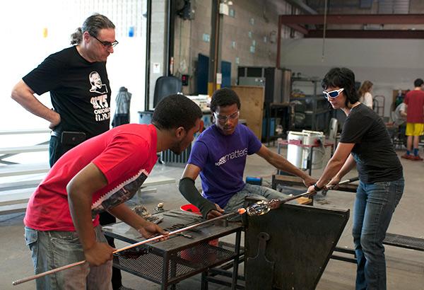 N'Kosi Barber, psychologist Brad Stolbach, Alex Harris, and glassblower Pearl Dick collaborate at Ignite Glass Studios.