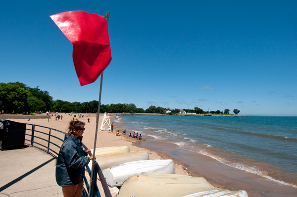 A red flag at 95th Street Beach signals the beach is closed for swimming