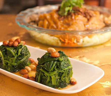 """Cold appetizers include spinach with peanut and vinegar and """"colorful wide cold noodle."""""""