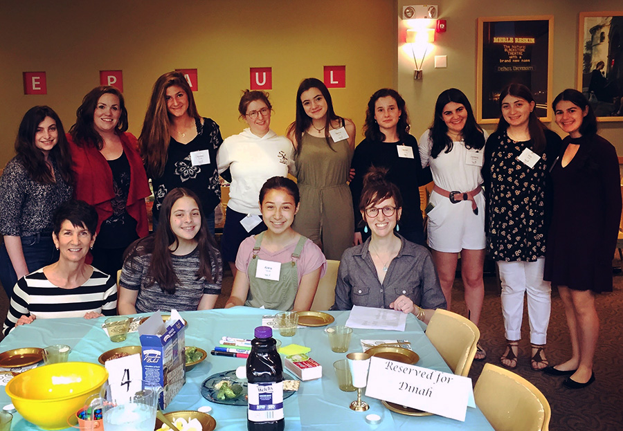 The RTI interns with DePaul and JUF faculty at the first-ever anti-rape culture seder last May at DePaul University.